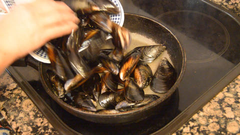 Mussels Into Hot Pan Footage