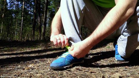 Sportsman tying shoelaces Footage