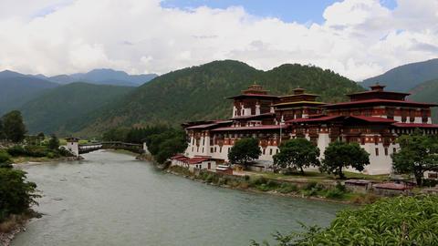Bhutan Punakha Dzong fortress building, near a river as a beautiful sight Footage
