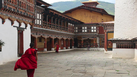 Bhutan monks walking in a monastery Footage