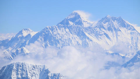 Mount Everest himalaya range panorama view flyby aerial shot crystal clear peak Footage