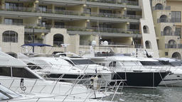 Super yachts moored at Portomaso Marina in St Julian, Malta ビデオ
