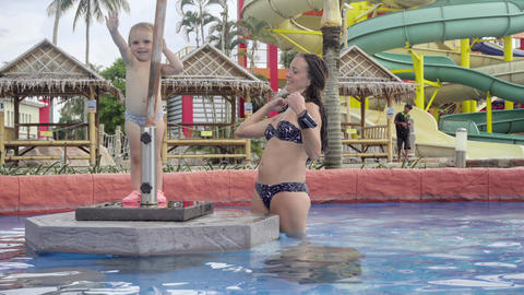 Mother and daughter in pool bar of hotel Footage