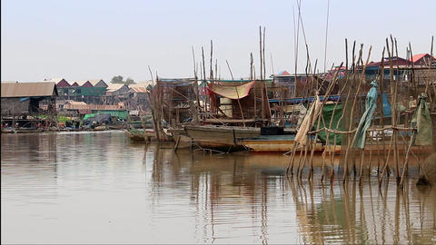 Cambodia Tonle Sap Lake boats and village Live Action