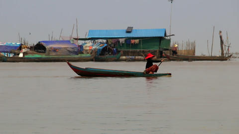 Cambodia Tonle Sap Lake woman on a boat Live Action