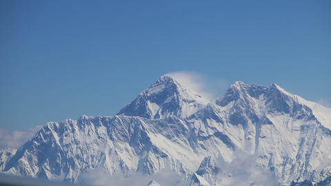 Mount Everest and himalaya panorama view from a plane flyby Live Action