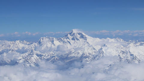 Mount Everest and himalaya panorama view from a plane with all surrounding peaks Live Action