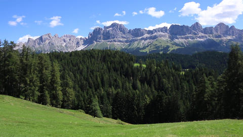 Italian dolomites Rosengarten mountains landscape panorama with a forest Footage