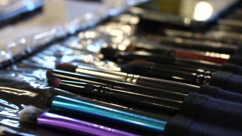 Makeup brushes in an organizer dolly shot Live Action
