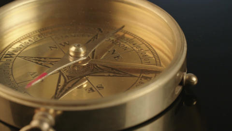 Macro shot of antique navigation instrument on dark background Bild
