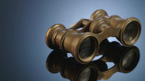 Antique binoculars on dark reflective background Footage