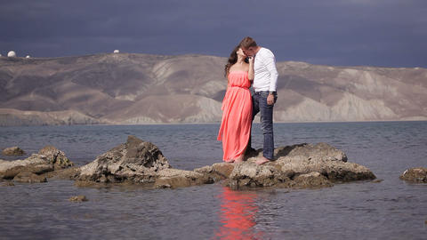 Lovers on the background of amazing scenery Live Action