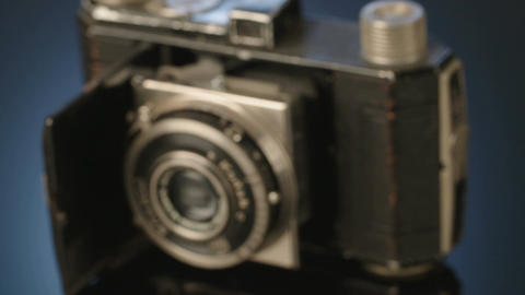 Antique camera on dark reflective background Footage