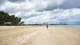 Man running on the beach Footage