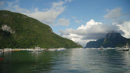 Seascape with island, mountains, boats on the water Footage