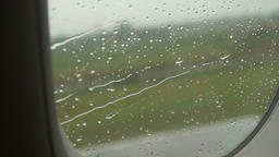 Rain drops on the window of the plane Footage