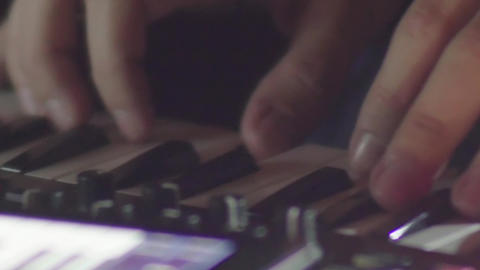 Hands of a musician and hit the keys a miniature organ music during a concert in Footage