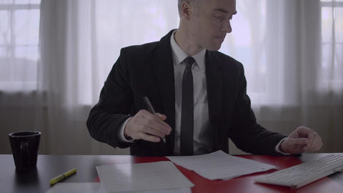 Man working at his desk Footage