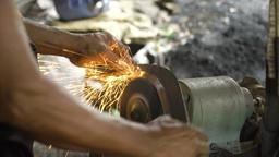 Sharpening the machete Footage