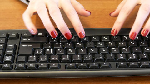 Business girl with a nice manicure typing on black keyboard Footage