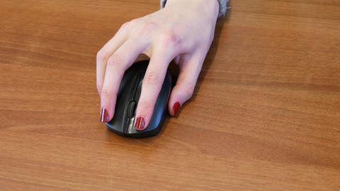 Female operates a computer mouse Footage