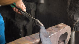 Blacksmith working metal with hammer Footage
