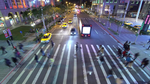 Time lapse of busy street traffic at night in Taipei, Taiwan Footage