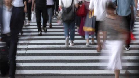 Urban landscape (crosswalk, pedestrian, time lapse, low speed shutter) Footage