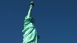 USA New York City 402 Liberty Island; Statue of Liberty against deep blue sky Footage