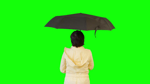 Close-up Of A Woman Opens An Umbrella. Green Screen stock footage