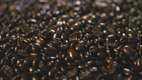 Organic Coffee Beans Extreme Close Up Falling And Landing On Pile Rotating Right stock footage