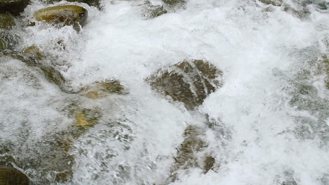 Follow Forest River Flowing Slow Motion Over Small Waterfalls Footage