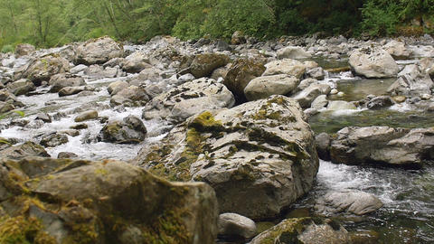 Mountain River with Rocks and Rapids of White Water in Slow Motion Footage