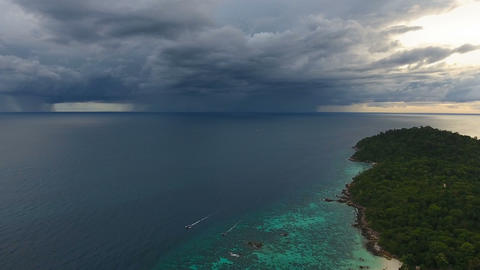 Flying over sea to thunderstorm on horizon, 4k Live Action