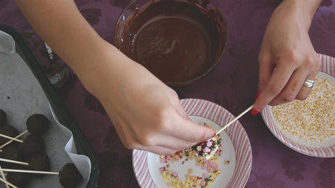 Woman making chocolate cakepops with sparkles Footage