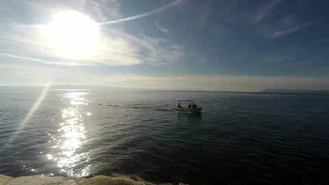 Sunny day on sea with fishermans in small boat timelapse Footage