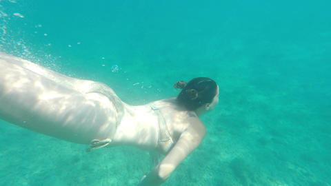 Young woman in bikini underwater Footage