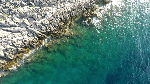 Aerial view of rocky coastline and blue sea Footage