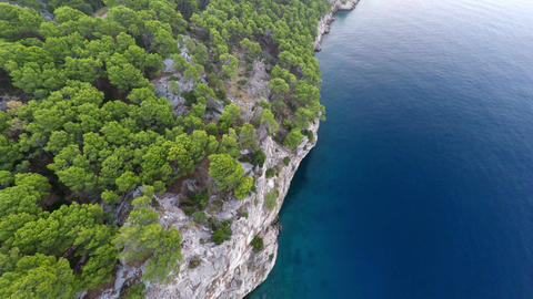 Aerial view of high cliff and blue calm sea
