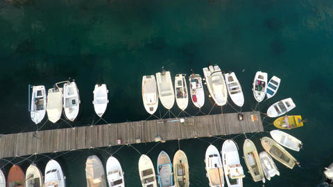 Small boats in harbor aerial view Footage