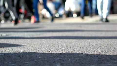 Pedestrians crossing the street blurred Footage