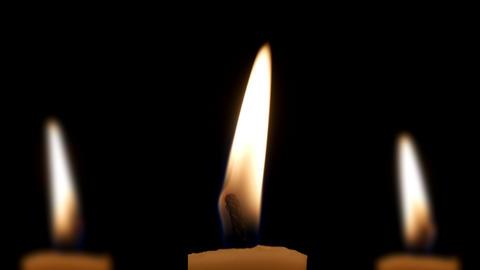 Three candles in dark Footage