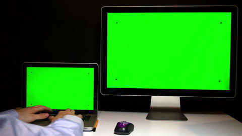 Man Working on the Laptop and Display with a Green Screen at the Workplace Footage