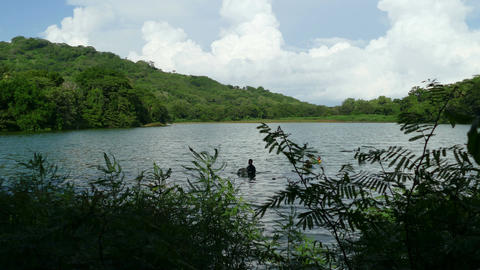 Fishermen throw nets in Charco Verde lake Footage