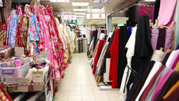 Walking in passage at colourful fabric market, thousands of textile products Footage