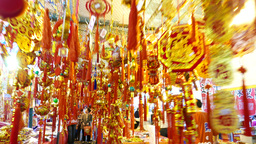 Moving back in cloud of hanging chinese new year decorations, market showcase Footage