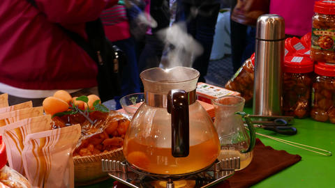 Modern glass teapot, white steam rise from boiling water, market showcase Footage