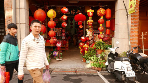 Small building entrance, decorated with many paper chinese lantern lamps Live Action