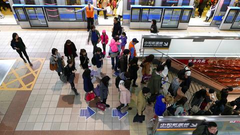 General view, people walk downstairs from metro platform, train doors close Footage