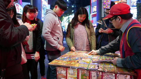 Man look in disbelief at lottery ticket and gives it to seller Live Action
